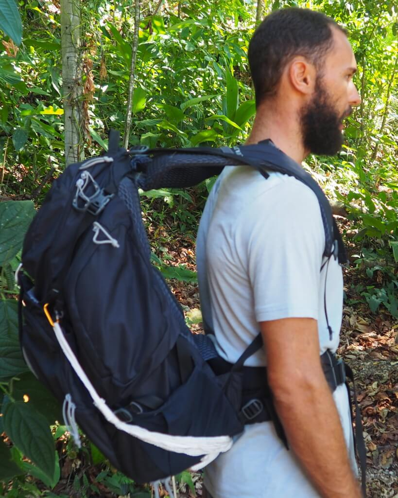 how to put on your backpack properly - before tightening shoulder straps